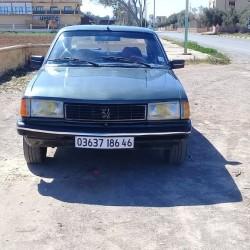 peugeot 305 moteur noir   annee 1986  vitres avants electrique  appelez 0670205910 ouedkniss